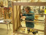 Bob working on a dresser in class